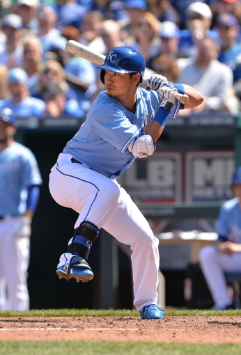 Apr 9, 2014; Kansas City, MO, USA; Kansas City Royals right fielder Nori Aoki (23) at bat against the Tampa Bay Rays during the fifth inning at Kauffman Stadium. Mandatory Credit: Peter G. Aiken-USA TODAY Sports