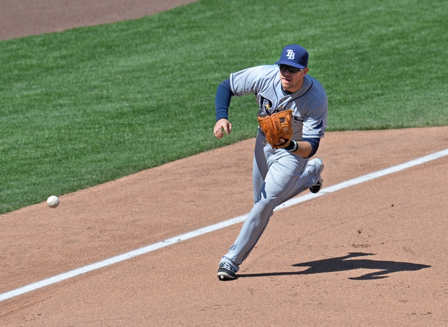 Apr 9, 2014; Kansas City, MO, USA; Tampa Rays third basemen Evan Longoria (3) charges a ground ball against the Kansas City Royals during the forth inning at Kauffman Stadium. Mandatory Credit: Peter G. Aiken-USA TODAY Sports