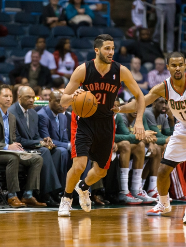 Apr 5, 2014; Milwaukee, WI, USA; Toronto Raptors guard Greivis Vasquez (21) during the game against the Milwaukee Bucks at BMO Harris Bradley Center.  Toronto won 102-98.  Mandatory Credit: Jeff Hanisch-USA TODAY Sports