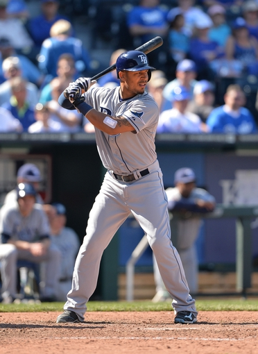 Apr 9, 2014; Kansas City, MO, USA; Tampa Rays center fielder Desmond Jennings (8) at bat against the Kansas City Royals during the ninth inning at Kauffman Stadium. Mandatory Credit: Peter G. Aiken-USA TODAY Sports