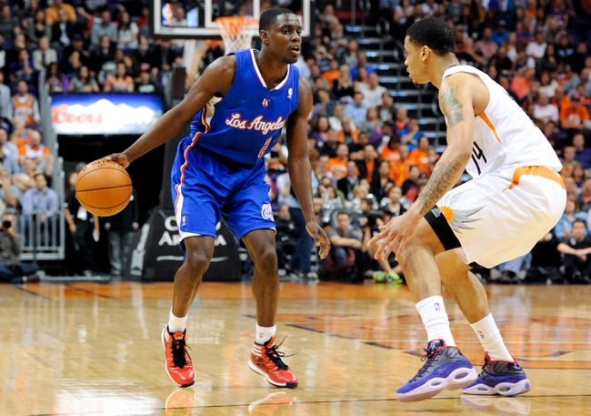 Apr 2, 2014; Phoenix, AZ, USA; Los Angeles Clippers guard Darren Collison (2) is defended by Phoenix Suns guard Gerald Green (14) during the second quarter at US Airways Center. The Clippers won 112-108. Mandatory Credit: Casey Sapio-USA TODAY Sports