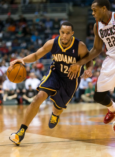 Apr 9, 2014; Milwaukee, WI, USA; Indiana Pacers forward Evan Turner (12) during the game against the Milwaukee Bucks at BMO Harris Bradley Center.  Indiana won 104-102.  Mandatory Credit: Jeff Hanisch-USA TODAY Sports