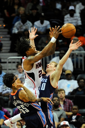 Apr 14, 2014; Atlanta, GA, USA; Atlanta Hawks forward Cartier Martin (20) shoots over Charlotte Bobcats center Cody Zeller (40) during the first half at Philips Arena. Mandatory Credit: Dale Zanine-USA TODAY Sports