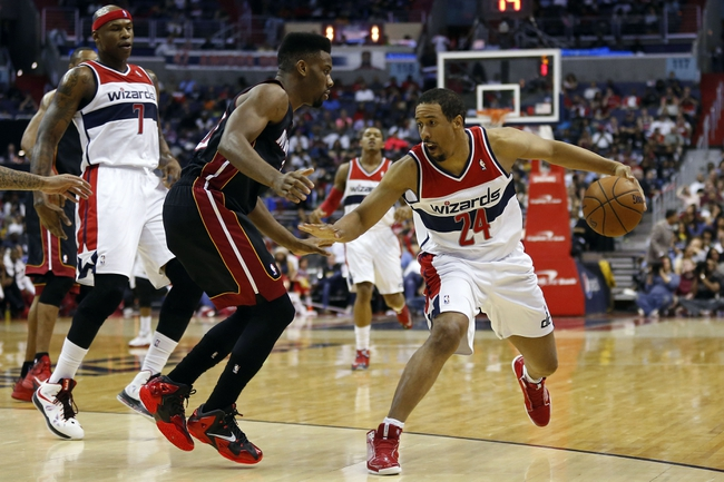 Apr 14, 2014; Washington, DC, USA; Washington Wizards guard Andre Miller (24) dribbles the ball as Miami Heat forward Udonis Haslem (40) defends in the second quarter at Verizon Center. Mandatory Credit: Geoff Burke-USA TODAY Sports
