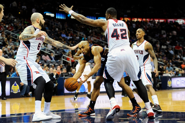 Apr 14, 2014; Atlanta, GA, USA; Charlotte Bobcats guard Gerald Henderson (9) loses the ball to the defense of Atlanta Hawks center Pero Antic (6) and forward Elton Brand (42) during the first half at Philips Arena. Mandatory Credit: Dale Zanine-USA TODAY Sports