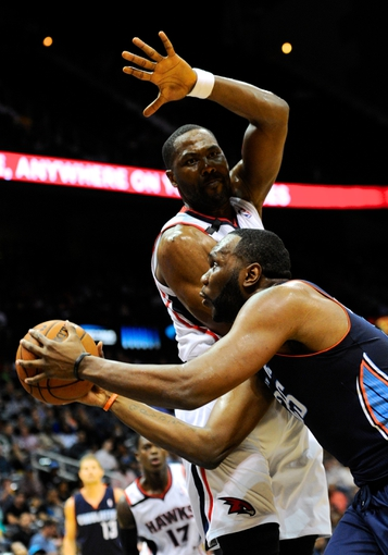 Apr 14, 2014; Atlanta, GA, USA; Charlotte Bobcats center Al Jefferson (25) works against Atlanta Hawks forward Elton Brand (42) during the first half at Philips Arena. Mandatory Credit: Dale Zanine-USA TODAY Sports