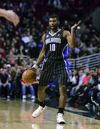 Apr 14, 2014; Chicago, IL, USA; Orlando Magic guard E'Twaun Moore (55) dribbles the ball against the Chicago Bulls during the second quarter at the United Center. Mandatory Credit: Mike DiNovo-USA TODAY Sports