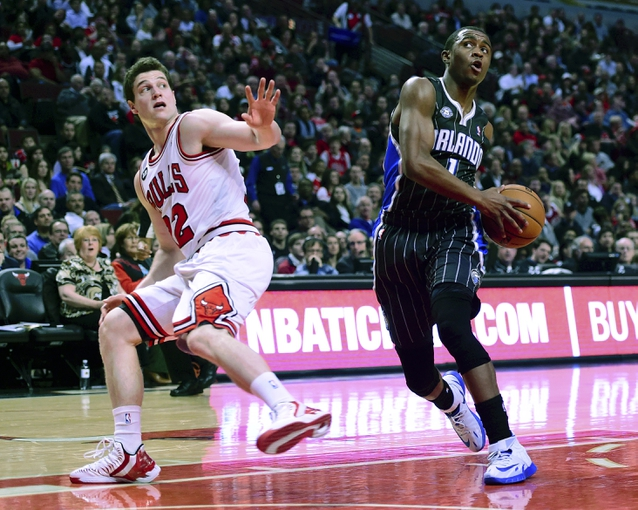 Apr 14, 2014; Chicago, IL, USA; Orlando Magic guard Doron Lamb (1) attempts to shoots the ball against Chicago Bulls guard Jimmer Fredette (32) during the second quarter at the United Center. Mandatory Credit: Mike DiNovo-USA TODAY Sports