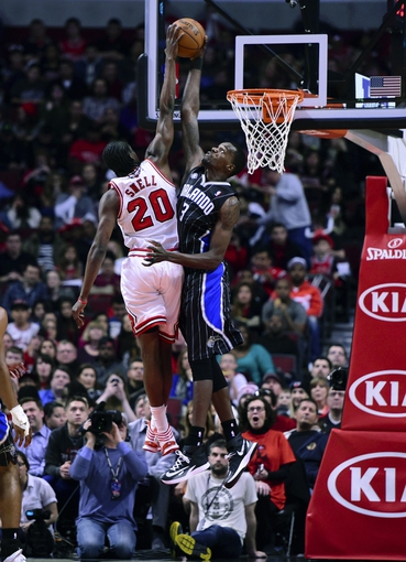 Apr 14, 2014; Chicago, IL, USA; Orlando Magic center Dewayne Dedmon (3) blocks the shot of Chicago Bulls guard Tony Snell (20) during the second quarter at the United Center. Mandatory Credit: Mike DiNovo-USA TODAY Sports