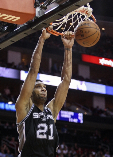 Apr 14, 2014; Houston, TX, USA; San Antonio Spurs forward Tim Duncan (21) dunks the ball during the second quarter against the Houston Rockets at Toyota Center. Mandatory Credit: Troy Taormina-USA TODAY Sports