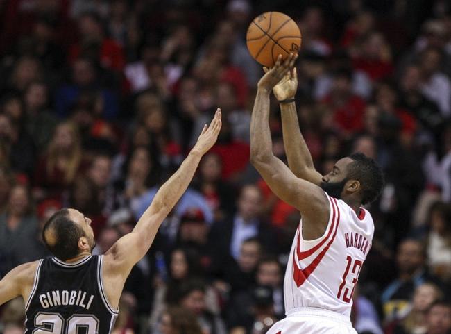 Apr 14, 2014; Houston, TX, USA; Houston Rockets guard James Harden (13) shoots during the second quarter as San Antonio Spurs guard Manu Ginobili (20) defends at Toyota Center. Mandatory Credit: Troy Taormina-USA TODAY Sports