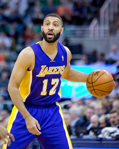 Apr 14, 2014; Salt Lake City, UT, USA; Los Angeles Lakers guard Kendall Marshall (12) controls the ball during the first quarter against the Utah Jazz at EnergySolutions Arena. Mandatory Credit: Russ Isabella-USA TODAY Sports