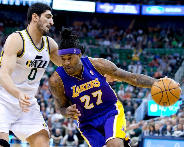Apr 14, 2014; Salt Lake City, UT, USA; Los Angeles Lakers forward Jordan Hill (27) drives against Utah Jazz center Enes Kanter (0) during the first quarter at EnergySolutions Arena. Mandatory Credit: Russ Isabella-USA TODAY Sports