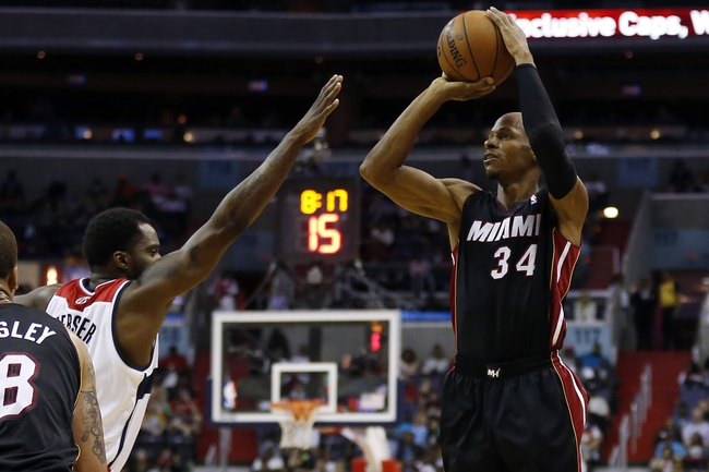 Apr 14, 2014; Washington, DC, USA; Miami Heat guard Ray Allen (34) shoots the ball over Washington Wizards forward Martell Webster (9) in the third quarter at Verizon Center. The Wizards won 114-93. Mandatory Credit: Geoff Burke-USA TODAY Sports