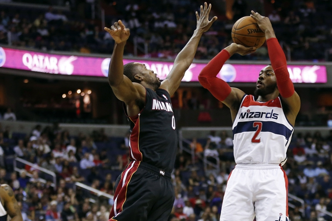 Apr 14, 2014; Washington, DC, USA; Washington Wizards guard John Wall (2) shoots the ball over Miami Heat guard Toney Douglas (0) in the first quarter at Verizon Center. Mandatory Credit: Geoff Burke-USA TODAY Sports