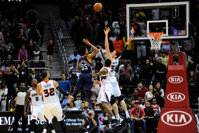 Apr 14, 2014; Atlanta, GA, USA; Charlotte Bobcats guard Chris Douglas-Roberts (55) makes a last second basket to win the game against the Atlanta Hawks during the second half at Philips Arena. The Bobcats defeated the Hawks 95-93. Mandatory Credit: Dale Zanine-USA TODAY Sports