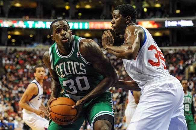 Apr 14, 2014; Philadelphia, PA, USA; Boston Celtics forward Brandon Bass (30) drives to the net as Philadelphia 76ers center Henry Sims (35) defends in the second quarter of the game at Wells Fargo Center. The Philadelphia 76ers won 113-108. Mandatory Credit: John Geliebter-USA TODAY Sports