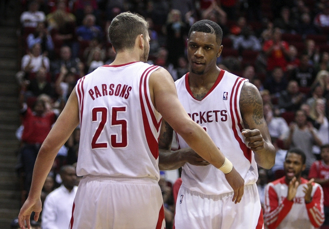 Apr 14, 2014; Houston, TX, USA; Houston Rockets forward Chandler Parsons (25) and forward Terrence Jones (6) celebrate after a play during the fourth quarter against the San Antonio Spurs at Toyota Center. The Rockets defeated the Spurs 104-98. Mandatory Credit: Troy Taormina-USA TODAY Sports