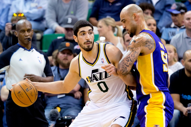 Apr 14, 2014; Salt Lake City, UT, USA; Los Angeles Lakers center Robert Sacre (50) defends against Utah Jazz center Enes Kanter (0) during the first half at EnergySolutions Arena. Mandatory Credit: Russ Isabella-USA TODAY Sports