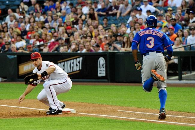 Apr 14, 2014; Phoenix, AZ, USA; Arizona Diamondbacks first baseman Paul Goldschmidt (44) catches the ball as New York Mets right fielder Curtis Granderson (3) runs to first base during the first inning at Chase Field. Mandatory Credit: Matt Kartozian-USA TODAY Sports