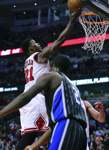 Apr 14, 2014; Chicago, IL, USA; Chicago Bulls guard Jimmy Butler (21) shoots the ball against Orlando Magic forward Maurice Harkless (21) during the second half at the United Center. Chicago defeats Orlando 108-95. Mandatory Credit: Mike DiNovo-USA TODAY Sports