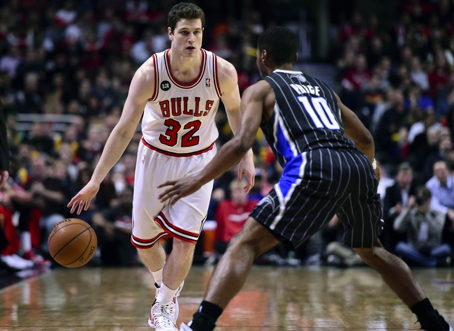 Apr 14, 2014; Chicago, IL, USA; Chicago Bulls guard Jimmer Fredette (32) dribbles the ball against Orlando Magic guard Ronnie Price (10) during the second half at the United Center. Chicago defeats Orlando 108-95. Mandatory Credit: Mike DiNovo-USA TODAY Sports