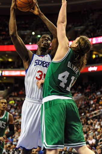 Apr 14, 2014; Philadelphia, PA, USA; Philadelphia 76ers center Henry Sims (35) takes a shot as Boston Celtics center Kelly Olynyk (41) defends during the third quarter of the game at Wells Fargo Center. The Philadelphia 76ers won 113-108. Mandatory Credit: John Geliebter-USA TODAY Sports