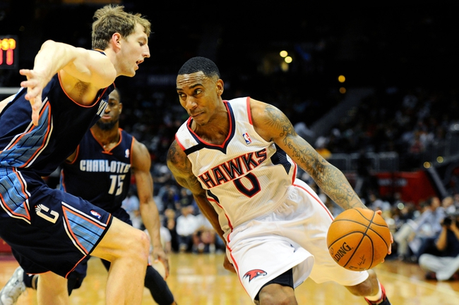 Apr 14, 2014; Atlanta, GA, USA; Atlanta Hawks guard Jeff Teague (0) drives the ball against Charlotte Bobcats center Cody Zeller (40) during the second half at Philips Arena. The Bobcats defeated the Hawks 95-93. Mandatory Credit: Dale Zanine-USA TODAY Sports