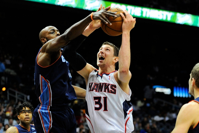 Apr 14, 2014; Atlanta, GA, USA; Charlotte Bobcats forward Anthony Tolliver (43) blocks the shot of Atlanta Hawks center Mike Muscala (31) during the second half at Philips Arena. The Bobcats defeated the Hawks 95-93. Mandatory Credit: Dale Zanine-USA TODAY Sports