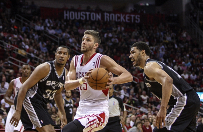 Apr 14, 2014; Houston, TX, USA; Houston Rockets forward Chandler Parsons (25) drives to the basket during the third quarter against the San Antonio Spurs at Toyota Center. The Rockets defeated the Spurs 104-98. Mandatory Credit: Troy Taormina-USA TODAY Sports