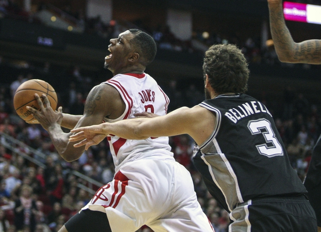 Apr 14, 2014; Houston, TX, USA; Houston Rockets forward Terrence Jones (6) attempts to score during the fourth quarter against the San Antonio Spurs at Toyota Center. The Rockets defeated the Spurs 104-98. Mandatory Credit: Troy Taormina-USA TODAY Sports