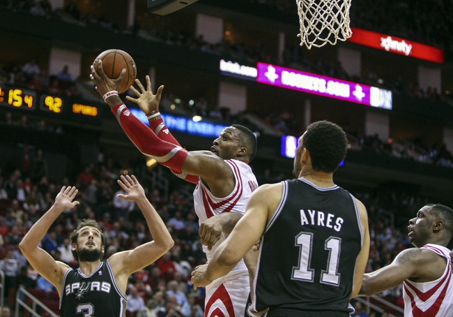 Apr 14, 2014; Houston, TX, USA; Houston Rockets center Dwight Howard (12) drives to the basket during the fourth quarter against the San Antonio Spurs at Toyota Center. Mandatory Credit: Troy Taormina-USA TODAY Sports