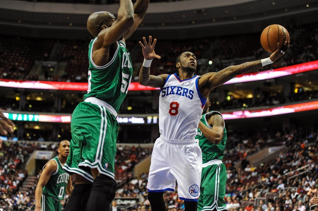 Apr 14, 2014; Philadelphia, PA, USA; Philadelphia 76ers guard Tony Wroten (8) shoots in the third quarter of the game against the Boston Celtics at Wells Fargo Center. The Philadelphia 76ers won 113-108. Mandatory Credit: John Geliebter-USA TODAY Sports