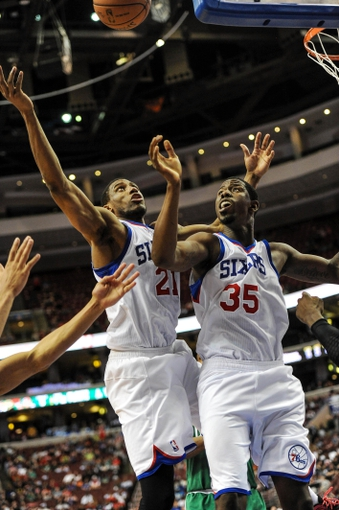 Apr 14, 2014; Philadelphia, PA, USA; Philadelphia 76ers forward Thaddeus Young (21) and Philadelphia 76ers center Henry Sims (35) jump for a rebound in the fourth  quarter of the game against the Boston Celtics at Wells Fargo Center. The Philadelphia 76ers won 113-108. Mandatory Credit: John Geliebter-USA TODAY Sports