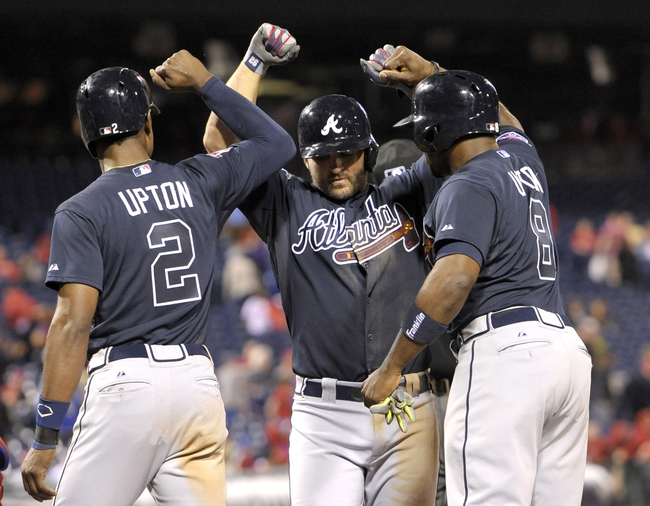 Apr 14, 2014; Philadelphia, PA, USA; Atlanta Braves second baseman Dan Uggla (26) celebrates his grand slam home run with center fielder B.J. Upton (2) and outfielder Justin Upton (8) in the ninth inning against the Philadelphia Phillies at Citizens Bank Park. The Braves defeated the Phillies, 9-6. Mandatory Credit: Eric Hartline-USA TODAY Sports
