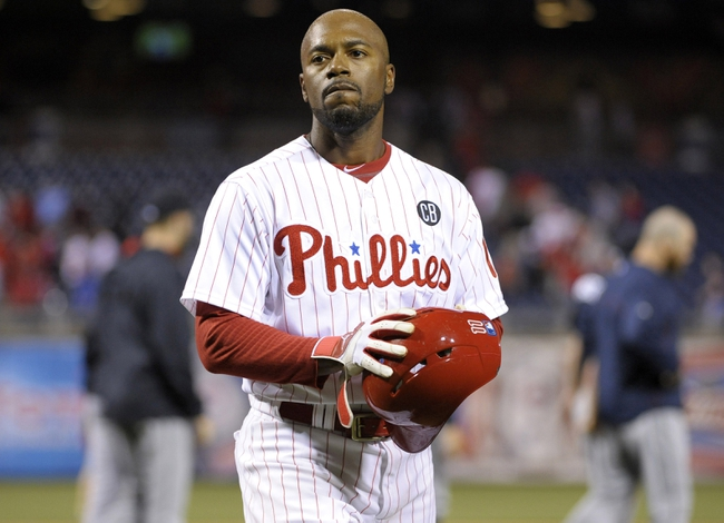 Apr 14, 2014; Philadelphia, PA, USA; Philadelphia Phillies shortstop Jimmy Rollins (11) walks off the field after losing to the Atlanta Braves at Citizens Bank Park. The Braves defeated the Phillies, 9-6. Mandatory Credit: Eric Hartline-USA TODAY Sports