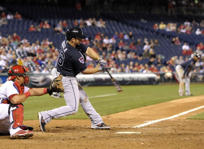 Apr 14, 2014; Philadelphia, PA, USA; Atlanta Braves second baseman Dan Uggla (26) hits a grand slam home run in the ninth inning against the Philadelphia Phillies at Citizens Bank Park. The Braves defeated the Phillies, 9-6. Mandatory Credit: Eric Hartline-USA TODAY Sports