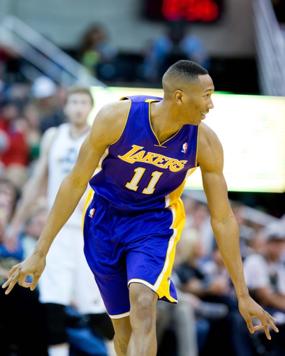 Apr 14, 2014; Salt Lake City, UT, USA; Los Angeles Lakers forward Wesley Johnson (11) reacts during the second half against the Utah Jazz at EnergySolutions Arena. The Lakers won 119-104. Mandatory Credit: Russ Isabella-USA TODAY Sports