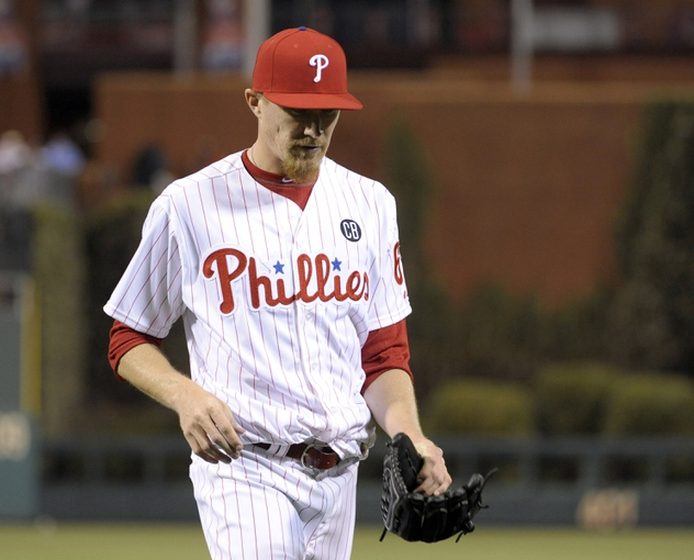 Apr 14, 2014; Philadelphia, PA, USA; Philadelphia Phillies relief pitcher Jacob Diekman (63) walks off the field in the ninth inning after allowing a grand slam home run against the Atlanta Braves at Citizens Bank Park. The Braves defeated the Phillies, 9-6. Mandatory Credit: Eric Hartline-USA TODAY Sports