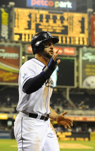 Apr 14, 2014; San Diego, CA, USA; San Diego Padres first baseman Yonder Alonso (23) reacts after scoring during the fifth inning against the Colorado Rockies at Petco Park. Mandatory Credit: Christopher Hanewinckel-USA TODAY Sports