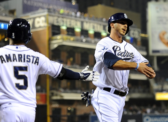 Apr 14, 2014; San Diego, CA, USA; San Diego Padres pinch hitter Tommy Medica (right) is congratulated by center fielder Alexi Amarista (5) after scoring during the fifth inning against the Colorado Rockies at Petco Park. Mandatory Credit: Christopher Hanewinckel-USA TODAY Sports