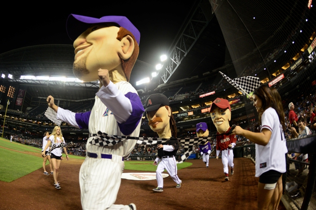 Apr 14, 2014; Phoenix, AZ, USA; The legends character of former Arizona Diamondbacks player Luis Gonzalez wins the legends race during the sixth inning against the New York Mets at Chase Field. Mandatory Credit: Matt Kartozian-USA TODAY Sports