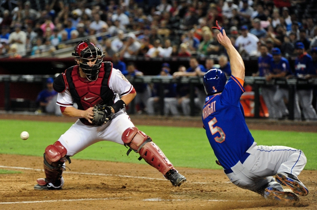 Apr 14, 2014; Phoenix, AZ, USA; New York Mets third baseman David Wright (5) scores as Arizona Diamondbacks catcher Miguel Montero (26) drops the ball during the fifth inning at Chase Field. Mandatory Credit: Matt Kartozian-USA TODAY Sports
