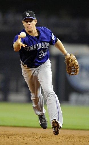 Apr 14, 2014; San Diego, CA, USA; Colorado Rockies first baseman Justin Morneau (33) tosses the ball to first for the final out of the sixth inning against the San Diego Padres at Petco Park. Mandatory Credit: Christopher Hanewinckel-USA TODAY Sports
