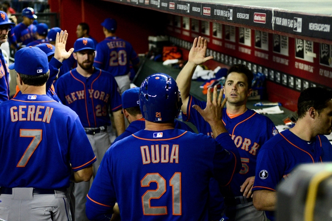 Apr 14, 2014; Phoenix, AZ, USA; New York Mets first baseman Lucas Duda (21) celebrates with teammates after scoring during the first inning against the Arizona Diamondbacks at Chase Field. Mandatory Credit: Matt Kartozian-USA TODAY Sports