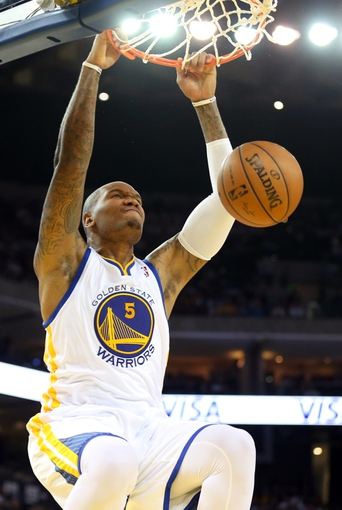 Apr 14, 2014; Oakland, CA, USA; Golden State Warriors forward Marreese Speights (5) dunks the ball against the Minnesota Timberwolves during the fourth quarter at Oracle Arena. The Golden State Warriors defeated the Minnesota Timberwolves 130-120. Mandatory Credit: Kelley L Cox-USA TODAY Sports