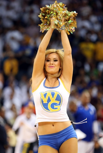 Apr 14, 2014; Oakland, CA, USA; Golden State Warriors dancer performs during a timeout against the Minnesota Timberwolves during the fourth quarter at Oracle Arena. The Golden State Warriors defeated the Minnesota Timberwolves 130-120. Mandatory Credit: Kelley L Cox-USA TODAY Sports