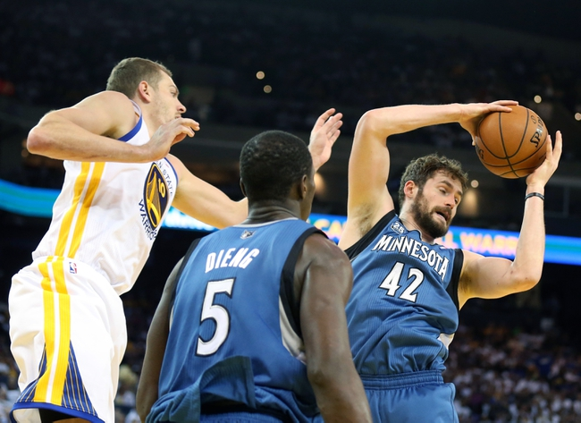 Apr 14, 2014; Oakland, CA, USA; Minnesota Timberwolves forward Kevin Love (42) controls a rebound against Golden State Warriors forward David Lee (10) with center Gorgui Dieng (5) during the third quarter at Oracle Arena. The Golden State Warriors defeated the Minnesota Timberwolves 130-120. Mandatory Credit: Kelley L Cox-USA TODAY Sports