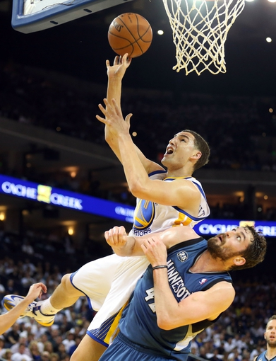 Apr 14, 2014; Oakland, CA, USA; Golden State Warriors guard Klay Thompson (11) shoots the ball against Minnesota Timberwolves forward Kevin Love (42) during the third quarter at Oracle Arena. The Golden State Warriors defeated the Minnesota Timberwolves 130-120. Mandatory Credit: Kelley L Cox-USA TODAY Sports
