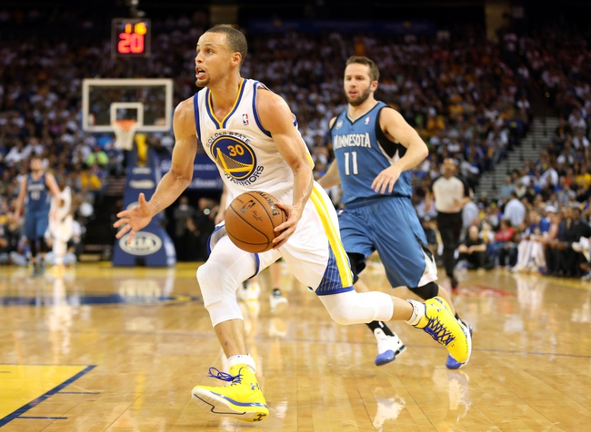 Apr 14, 2014; Oakland, CA, USA; Golden State Warriors guard Stephen Curry (30) drives in ahead of Minnesota Timberwolves guard J.J. Barea (11) during the third quarter at Oracle Arena. The Golden State Warriors defeated the Minnesota Timberwolves 130-120. Mandatory Credit: Kelley L Cox-USA TODAY Sports